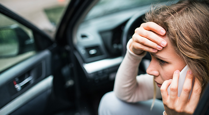 Woman calls the Miami car accident lawyers at Gillis, Mermell & Pacheco, P.A. following an accident