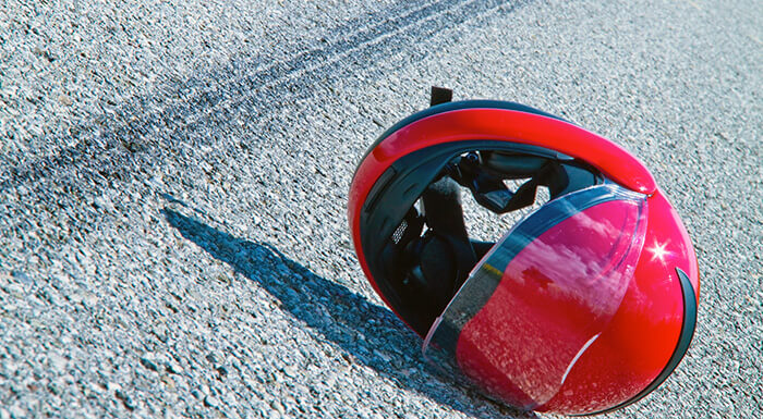 Helmet on the floor after a motorcycle accident, the driver will need a Miami motorcycle accident lawyer