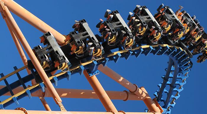 Patrons ride a rollercoaster at an amusement park