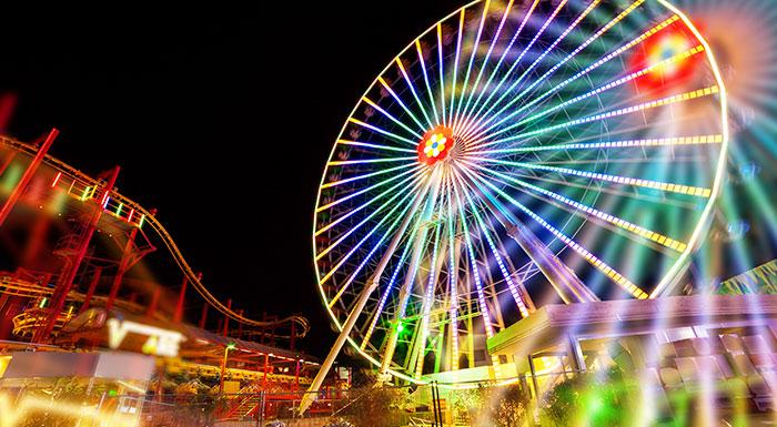 Landscape shot of a lit up amusement park. Amusement parks can be dangerous, injured patrons should contact a skilled Miami amusement park lawyer today.